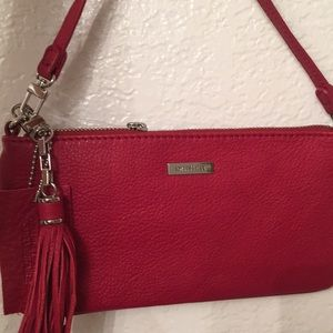 Danier red wristlet with fringe